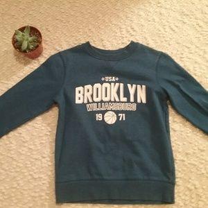 A cute cute blue varsity Brooklyn sweater.